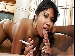 Asian at great cost in the matter of cute pair smokes gasper plus gets cum facial in the sky sofa